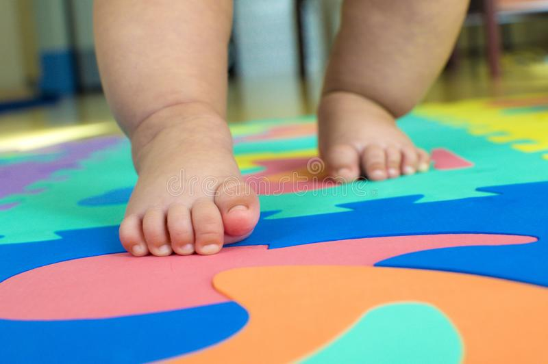 Small baby steps. A baby is learning to walk for the first time royalty free stock images