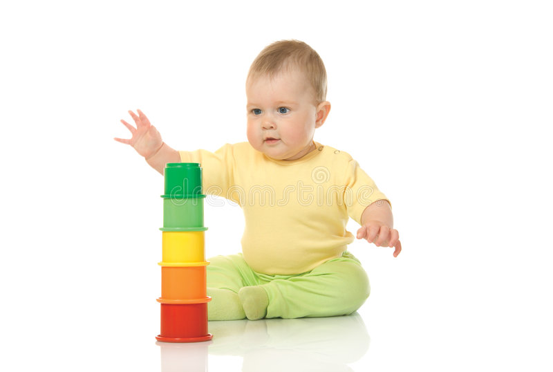 Small baby with a toy pyramid isolated royalty free stock photo
