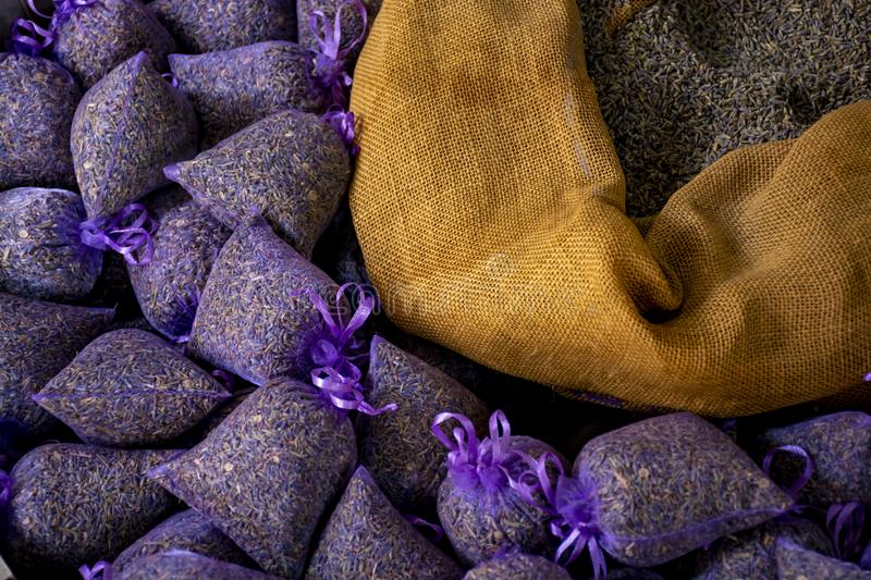 Small bags with aromatic seeds of lavender plant on market in Provence. Small violet bags with aromatic seeds of lavender plant on market in Provence, close up royalty free stock photos