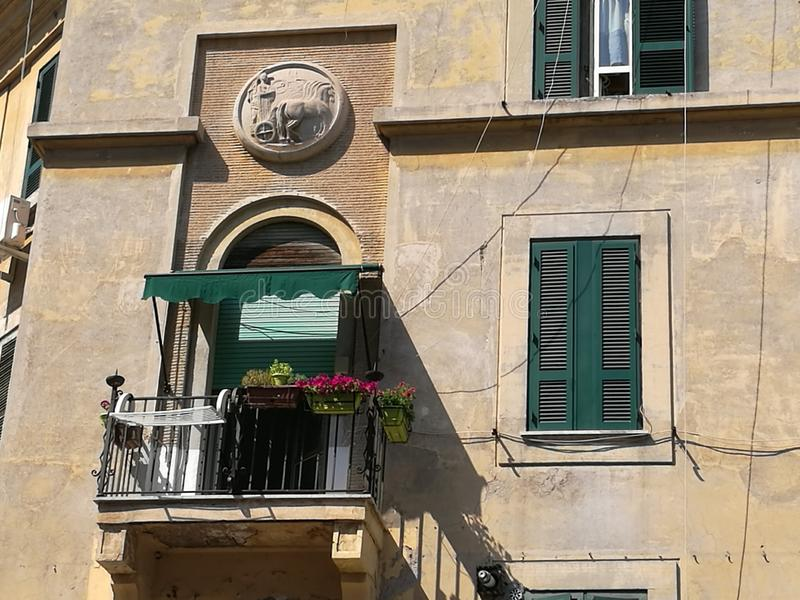 Small balconie of a characteristic ancient building in the district Garbatella in Rome, Italy. royalty free stock photos