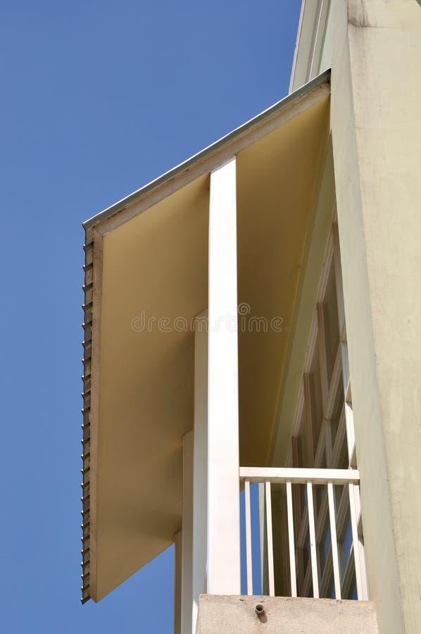 Small balcony with shield under blue sky