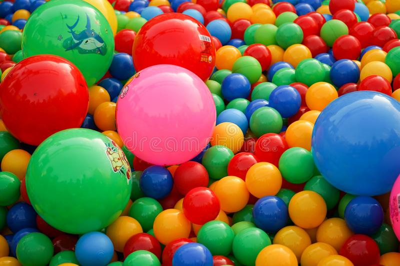 Small balls of different colors on the Playground stock photo