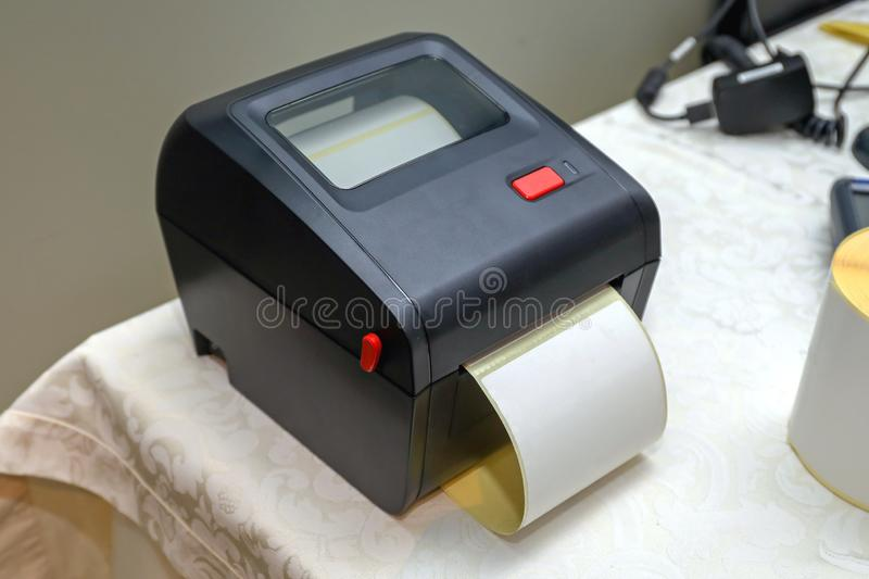 Small Bar Code Printer. Small Barcode Label Printer Equipment for Distribution Warehouse stock photos