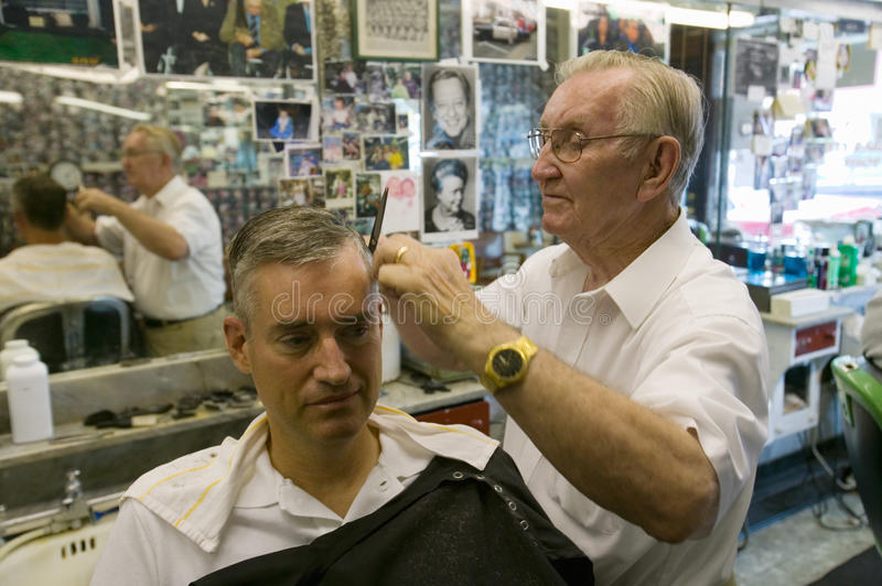 Small barbershop. Floyd cutting hair at Floyd's City Barber Shop in Mount Airy, North Carolina, the town featured in �Mayberry RFD� and home of Andy stock photo