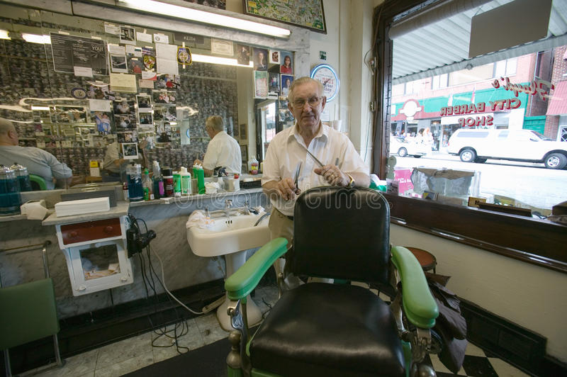 Small barbershop. Floyd cutting hair at Floyd's City Barber Shop in Mount Airy, North Carolina, the town featured in �Mayberry RFD� and home of Andy stock photography