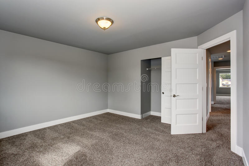 Small Basement Room Interior With Grey Walls And White Trim Stock Photo Image Of Style