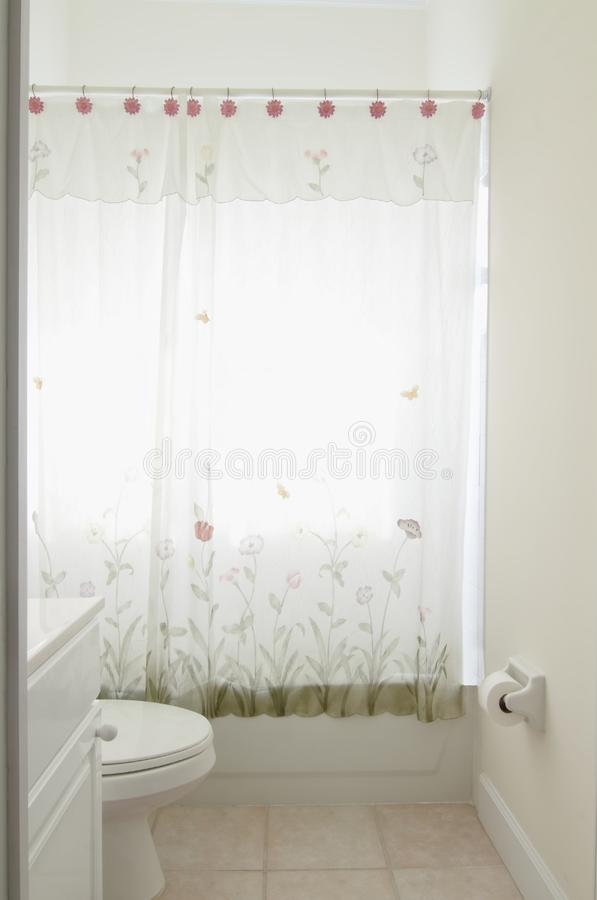 Small Bathroom. Overview of a small outdated bathroom in a private residence royalty free stock photo