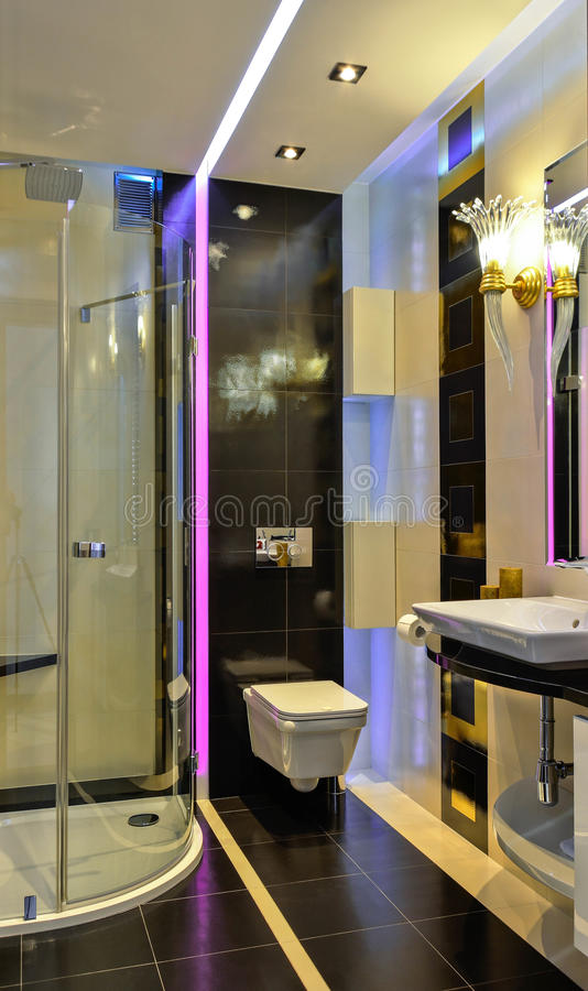 Small bathroom fot.3. Modern small bathroom with exclusive extras, LED lighting and cubic decorations royalty free stock photos