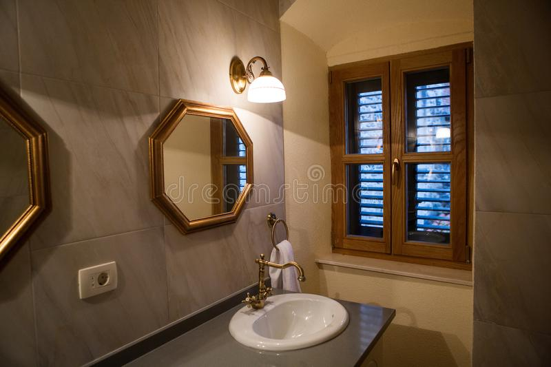 Small bathroom with mirror stock images