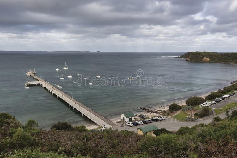 Small bay with jetty stock photography