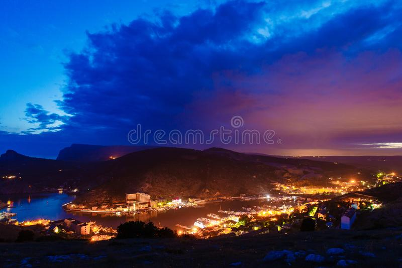 Small bay at night. Town near sea in evening royalty free stock photography