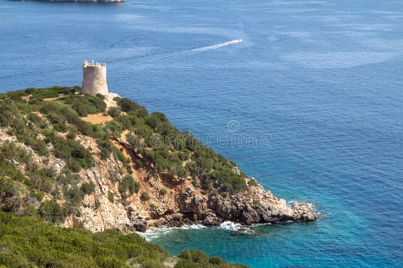 Small bay with Ruins of Ancient Watchtower in Sardinia stock image