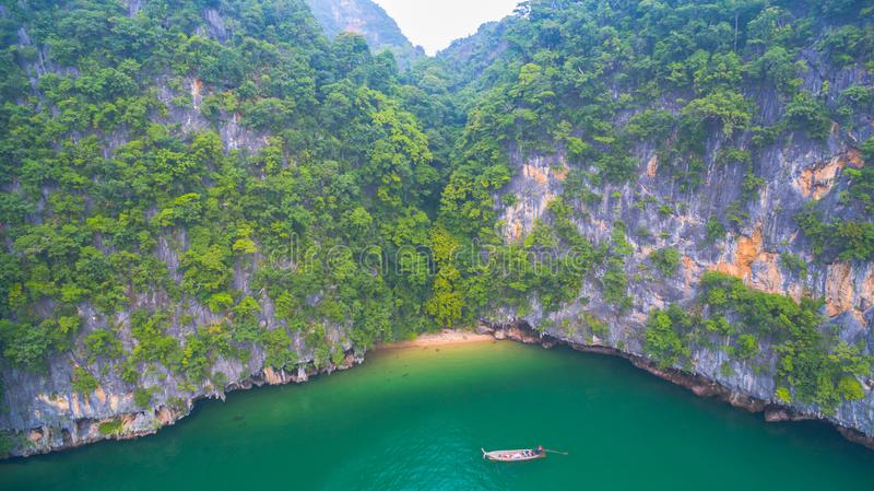 Aerial view Koh Yao Yai is in Phang Nga , Thailand. A small beach in high tide at Panak island when low tide can walk in tothe cave. Panak island is in Phang royalty free stock photo