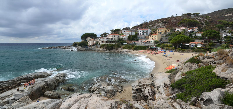 Small beach Spiagga di Seccheto in the south of Elba island. stock photography