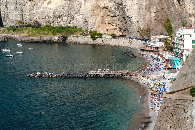 Small beach under tall cliffs on Sorrento coast, Italy, travel concept design, space for text stock photo