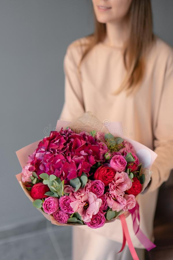 Small Beautiful bouquet of mixed flowers in woman hand. Floral shop concept. Flowers delivery. royalty free stock photography