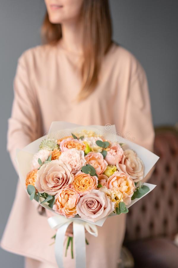 Small Beautiful bouquet of mixed flowers in woman hand. Floral shop concept. Flowers delivery stock images