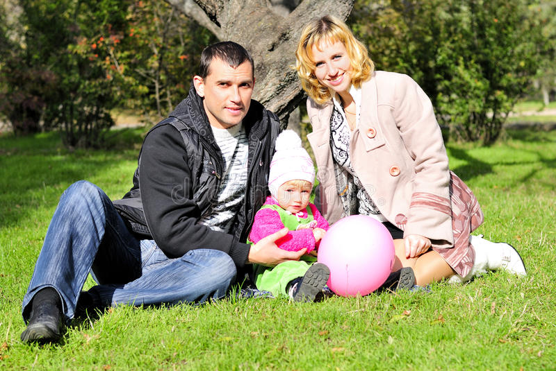 Download Small Beautiful Girl With Parent On Green Glade Stock Photo - Image: 21985126