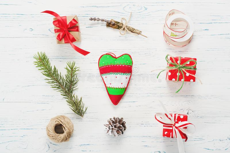 Small beautifully wrapped gifts, top view. Small beautifully wrapped gifts on a white wooden background stock photos