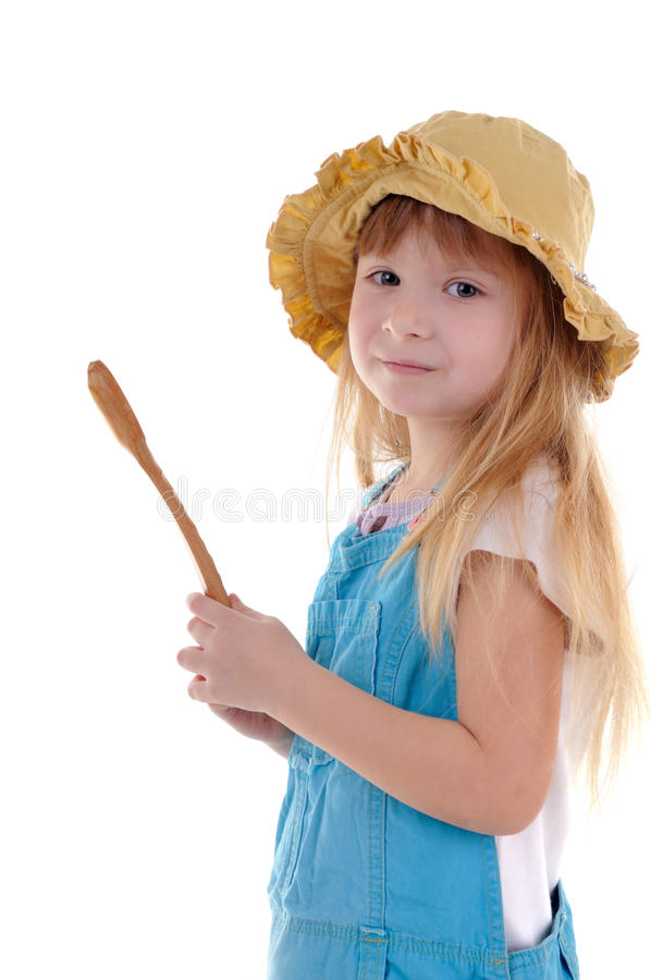 Small beauty girl with big wooden spoon royalty free stock photography