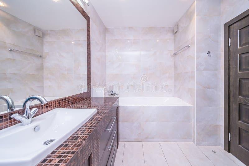 Small beige bathroom stock image