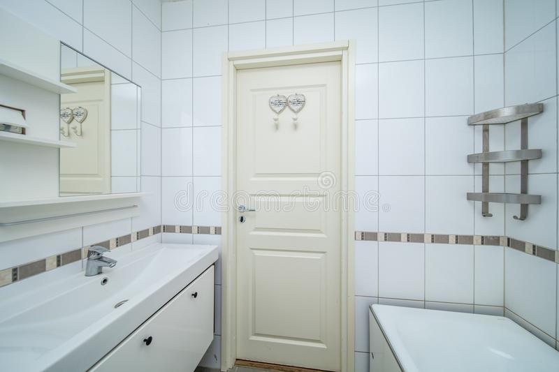 Small beige bathroom stock photography