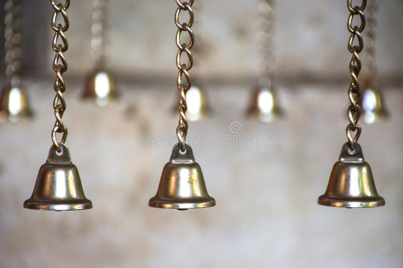 Small bell group hanging on the chain. Lucky symbol. Selective focus royalty free stock photo
