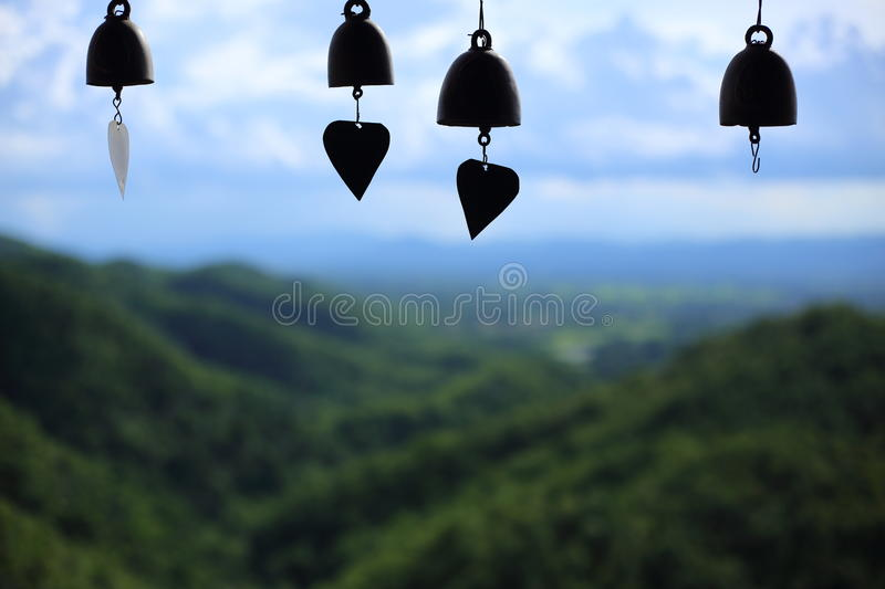Small bell and Mountains view at Wat Pratad Doi Leng stock images