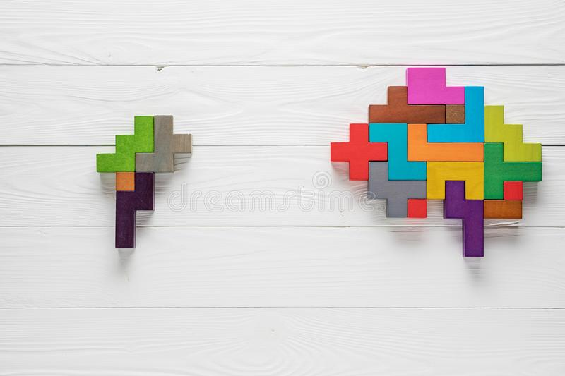 Small and big abstract brain. Genetic Brain disorder. Health and ailing brain. Mental health and mental disorder concept. Small and big abstract brain stock photography