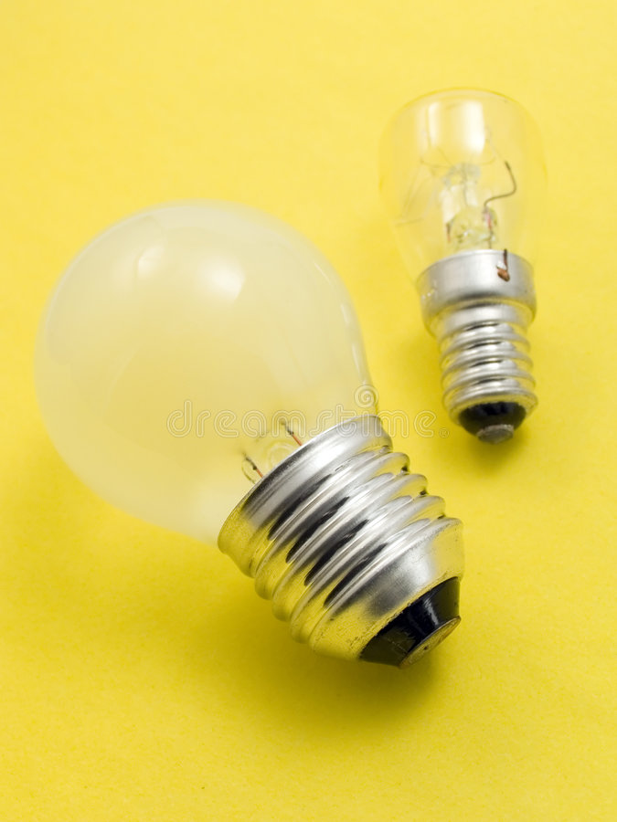 Small and big electric bulbs stock image