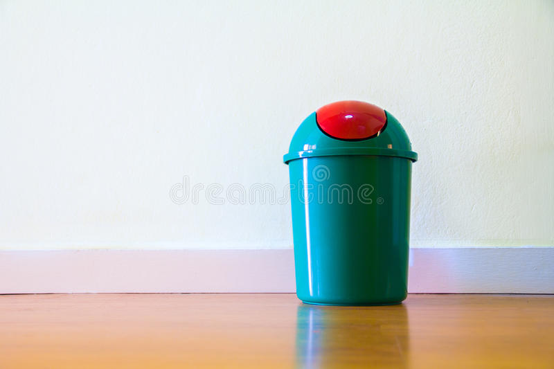 Small bin. Green bin placed in the home stock photography