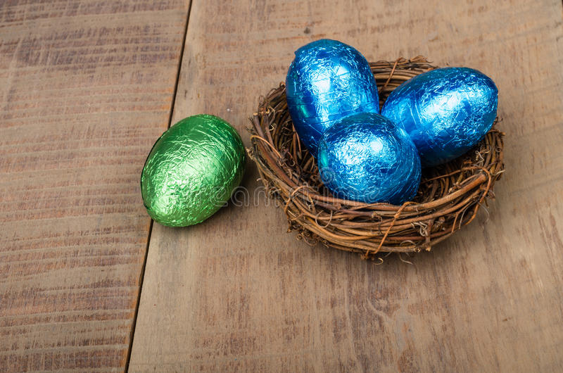 Small Bird S Nest With Four Foil Eggs Stock Image