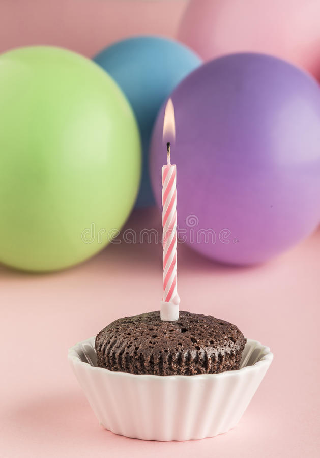 Small birthday cake with one candle royalty free stock images