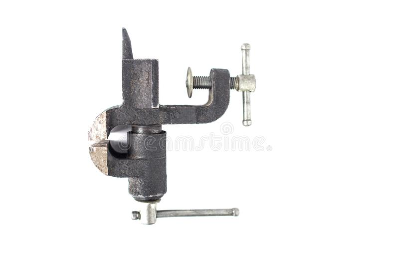 Small black desktop vise, close-up, isolate, scavenger`s daughter stock images