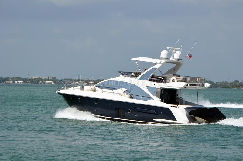 Small black and white luxury motor yacht royalty free stock images