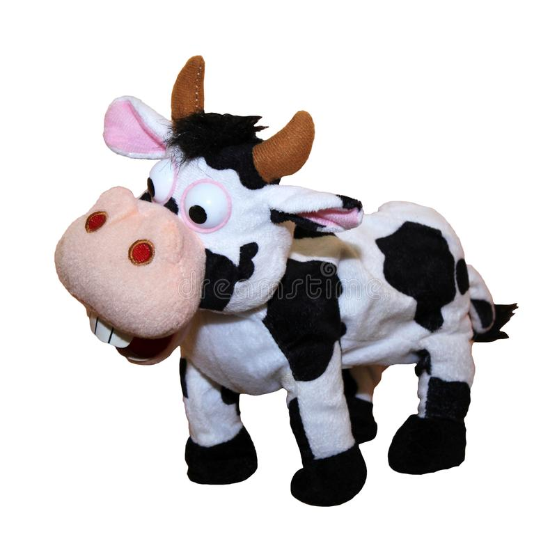 Small black and white toy cow against white background stock photos