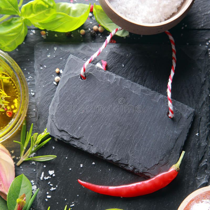 Small Black Wooden Tag on Table. Small Black Wooden Tag with Red Chili Pepper on Table royalty free stock photography