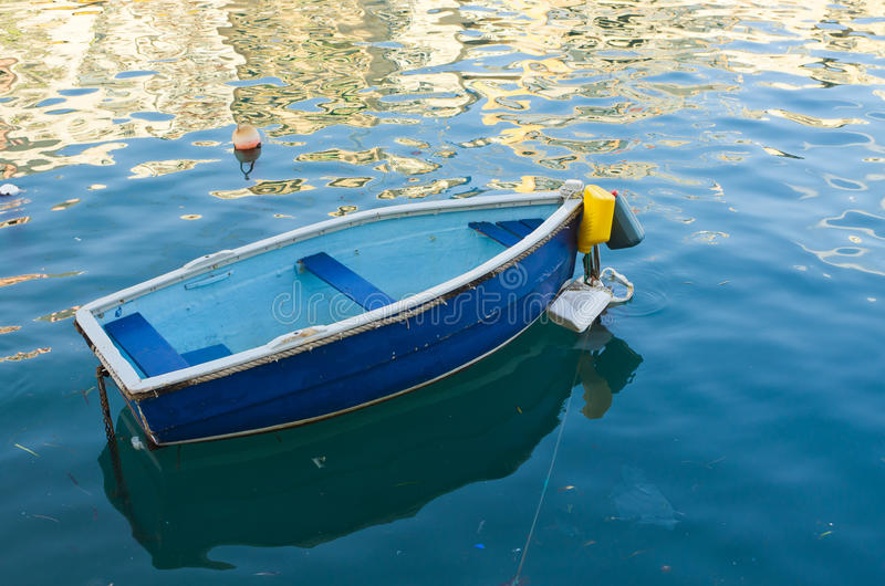 Small blue boat stock photography