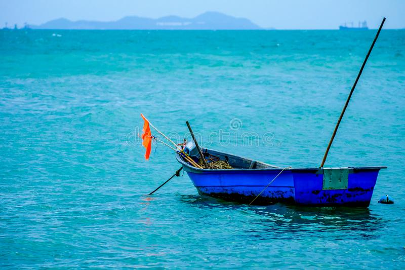 Small blue boat parking on sea royalty free stock photos