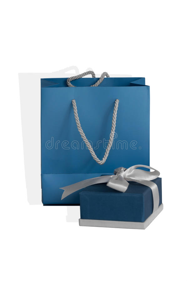 Small blue box tied with a silver ribbon and gift paper-bag as a set stock image