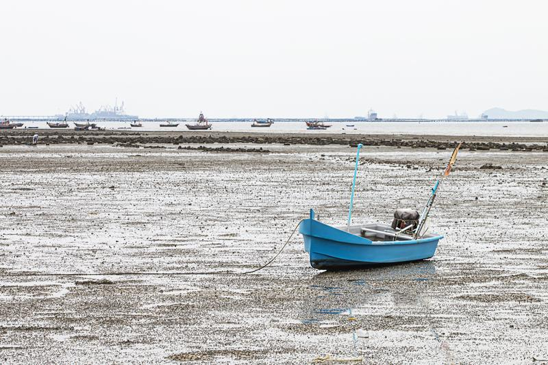 A small blue fishing boat parked at the pier.  royalty free stock images