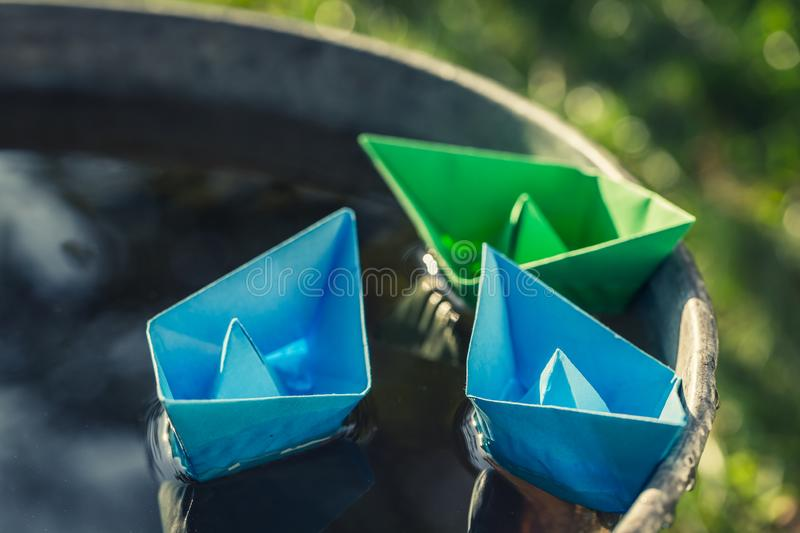 Small blue paper boats as toned and filtered photo royalty free stock photos