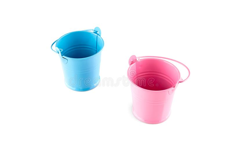 Small blue and pink buckets. Isolated on white background.  stock photos