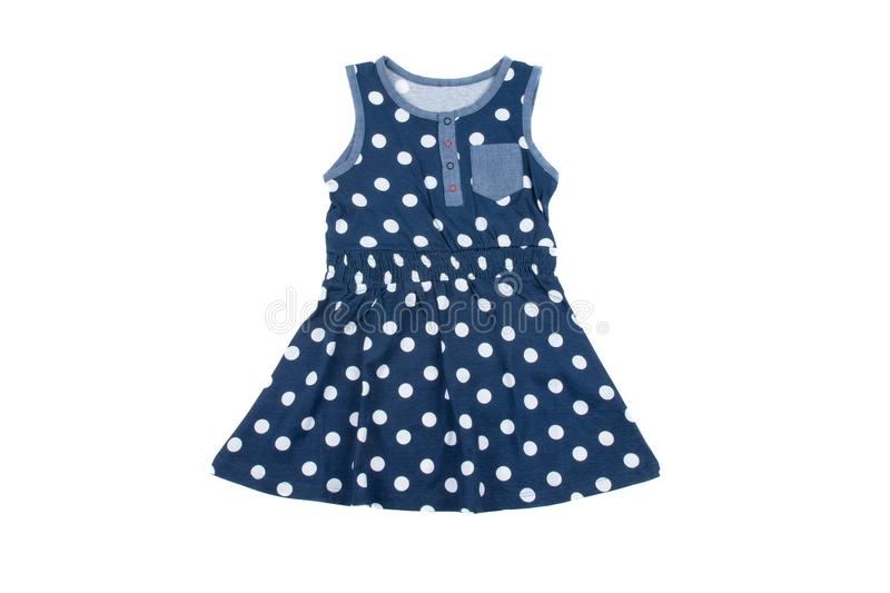 Small blue polka dot dress for girls, isolated on white stock photography