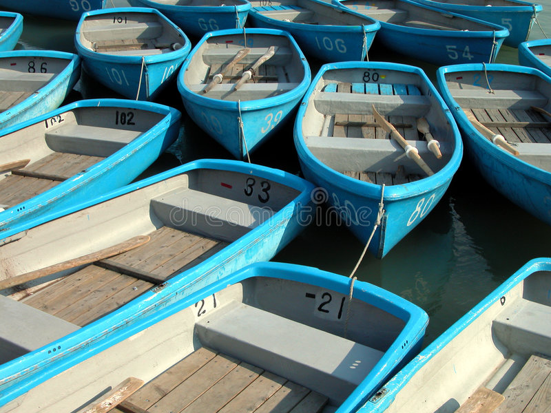 Small blue rowboats royalty free stock images