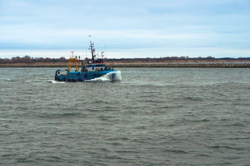 Small blue ship, small fishing boat. Small fishing boat, small blue ship, Baltic sea stock photo
