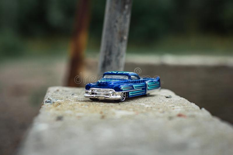 Small blue toy pickup truck on old concrete royalty free stock photo