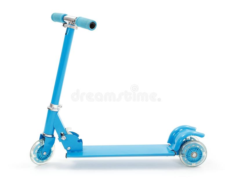 Small blue toy scooter. With three wheels royalty free stock photography