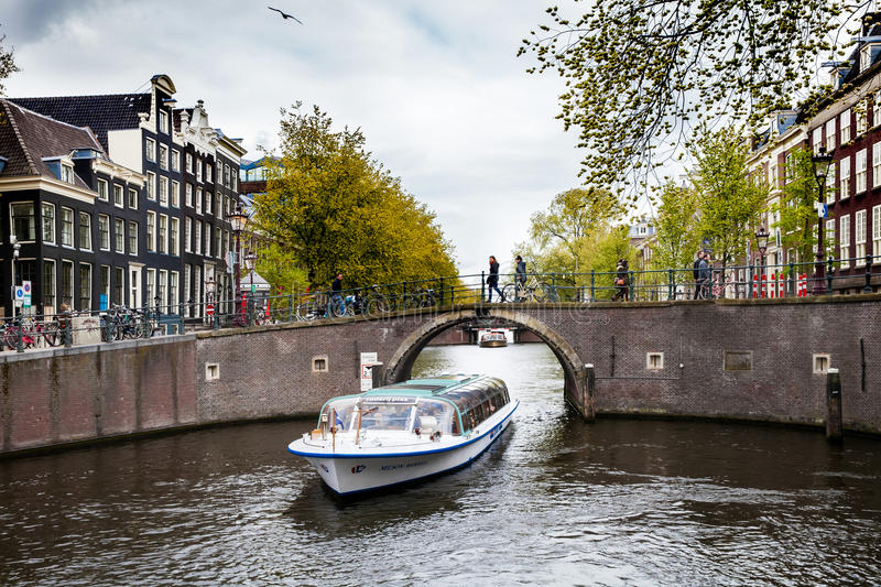 Small boat canal cruise in Amsterdam city, Netherlands stock image