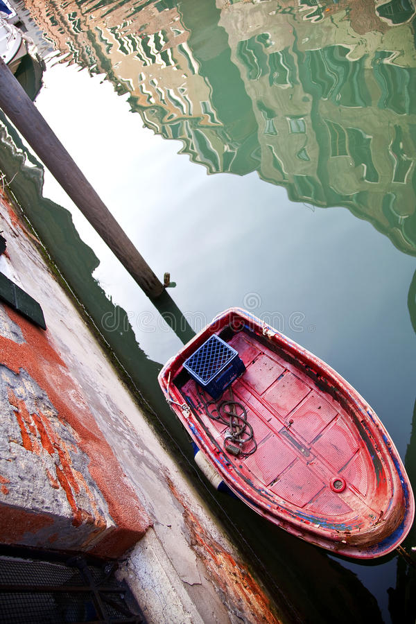 Small boat on a canal in Venice. Italy stock images